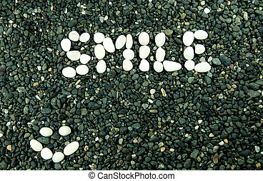 white stone forming smile word
