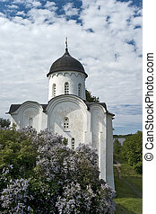 White stone russian church with lilac
