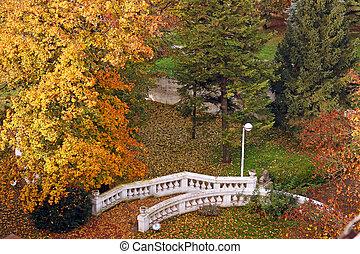 white stone staircase in park autumn season