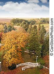 white stone staircase in park landscape autumn season