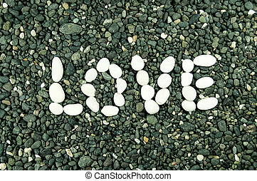 white stones forming the word love