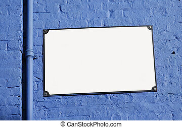 White Street Sign Board on Blue Background