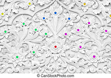 White stucco design of native thai style on the Wall