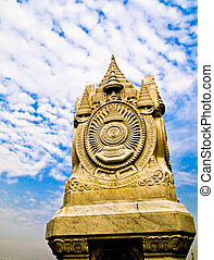 White stupa in Thai traditional style with blue sky