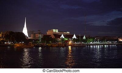 White stupa shrine of buddhism at night in Bangkok, Thailand