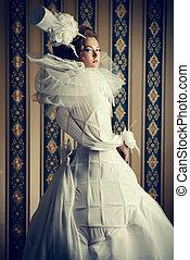white style - Beautiful fashion model in the refined white...