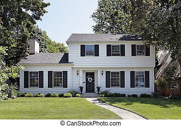 White suburban home - View of suburban home with white ...