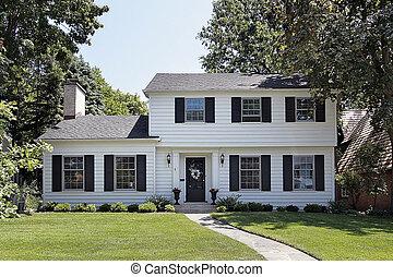 White suburban home - View of suburban home with white...