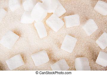 White sugar cubes and crystal sugar