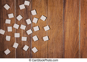White sugar cubes on wooden background. Copy space. Top view