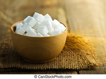 white sugar in a wooden bowl