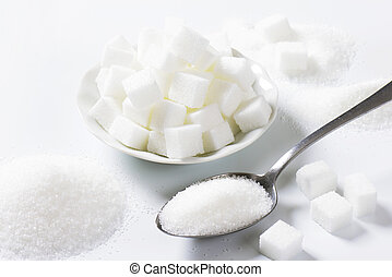 White sugar - Spoonful of fine granulated sugar and pile of...