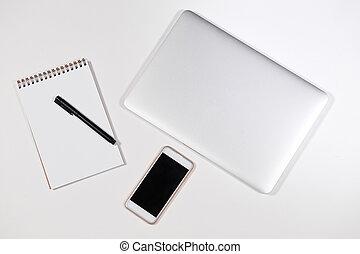 white supplies on the white desk