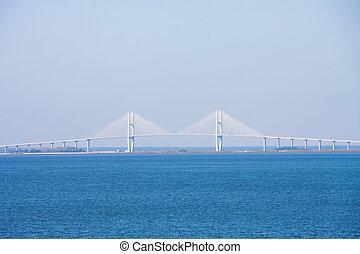 White Suspension Bridge Over Blue Sea