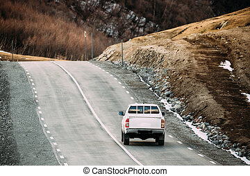 White SUV Car Moving On Mountain Road In Autumn Mountains Landscape. Drive And Travel Concept