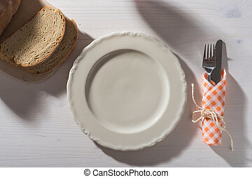 White Table With Empty Plate