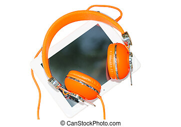 White tablet computer with orange headphones isolated on...