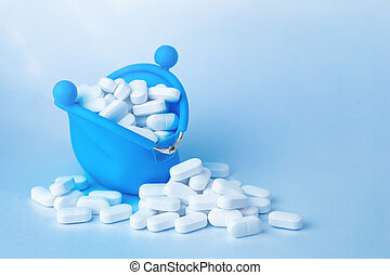 White tablets falling out of purse, drugs and medicine