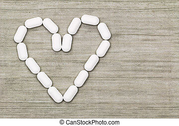 White tablets in a heart shaped symbol with copyspace - Top ...