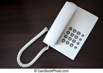white telephone on wooden background