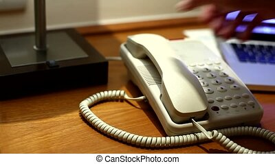 White Telephone Ringing in the room
