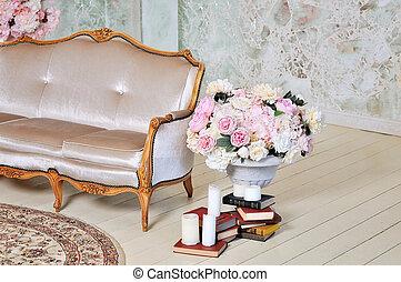 White textile classical style sofa.