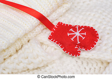 white texture knitted scarf and hat with a red mitten