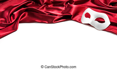 White theatre mask on red silk fabric