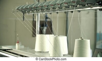 White thread spools at rewinding machine video - Big spools...