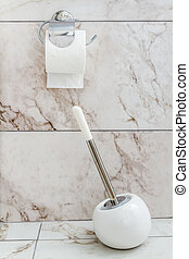 White Toilet Brush and Paper in a Bathroom