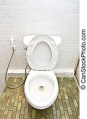 White toilet in very clean bathroom
