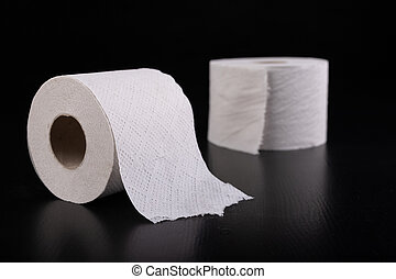 White toilet paper on a dark table. Articles for daily hygiene.