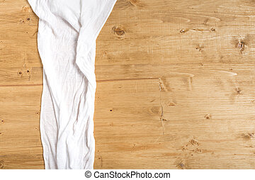 white towel on a wooden background with space for text