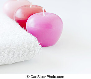 White towel with pink candles spa concept