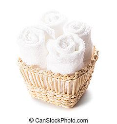 White towels - White spa towels pile in a basket isolated