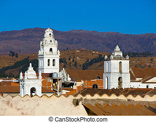 White colonial towers and orange rooftops in Sucre (Bolivia)