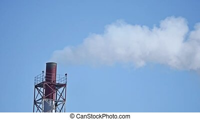white toxic fume from coal power plant. pipe industry smoke blue sky