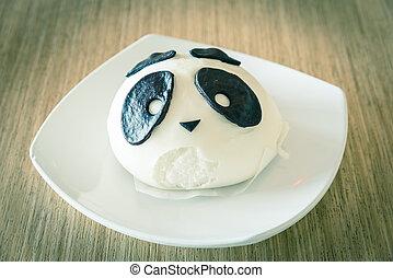 White traditional Chinese panda bear dumpling on desert plate