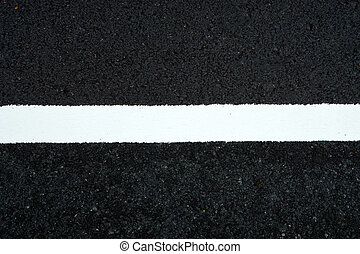 White Traffic lines on the road.