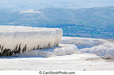 White travertine terrace formations, dry pool in Pamukkale, Turkey
