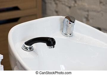 White triple hair washing sink for hairdresser salon closeup