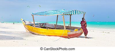 White tropical sandy beach on Zanzibar. - Maasai warrior...