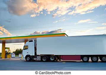 White truck is at a fuel station.