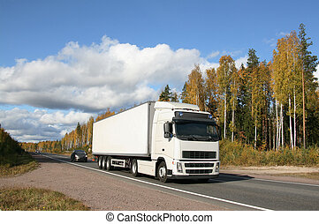 autumn highway - white truck on autumn highway
