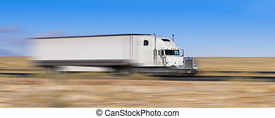 white truck on the move in the desert