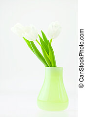 white tulips in a green vase