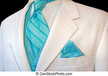 White Tuxedo - Bright turquoise accessories accenting a...