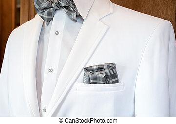 white tuxedo with plaid bow tie