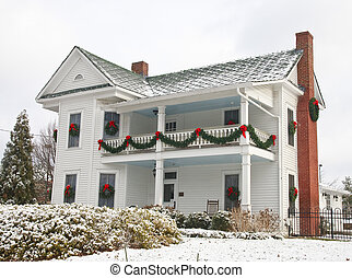 White Two Story House Decorated for Christmas in Snow - A...