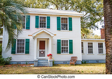 White Two Story with Green Shutters